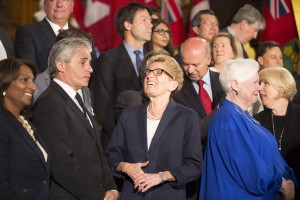 Premier Kathleen Wynne and new Housing Minister Bill Mauro share a laugh following a cabinet shuffle. (PETER POWER/THE CANADIAN PRESS)