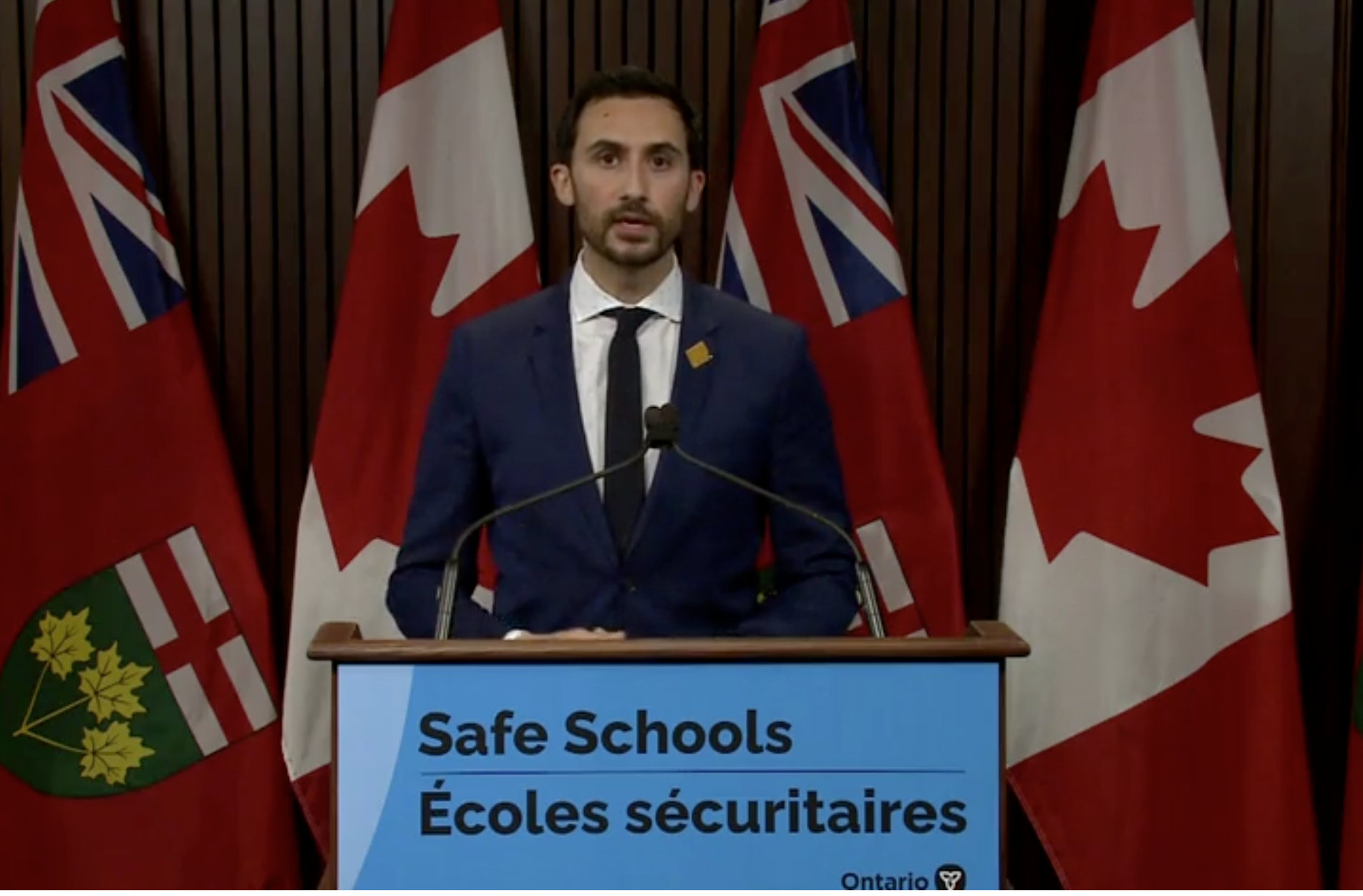 Education minister says asymptomatic testing target will improve safety in schools, but opposition says it's 'not adequate'